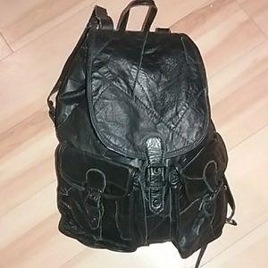Oversized black patchwork backpack.